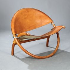 """1323/9150 - Jørgen Høvelskov: An extremly rare """"Circle-chair"""" with folding frame of pine wood, metal fittings. Seat and back with thick patinated natural leather."""