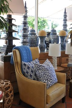 Leather #arm #chair with blue and white #porcelain #jars and #toss #pillows at #PalmBeach #Mecox #interiordesign #MecoxGardens #furniture #shopping #home #decor #design #room #designidea #vintage #antiques #garden