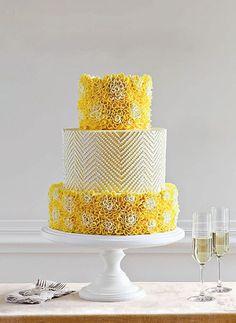 A yellow dahlia wedding cake | Brides.com