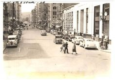 """A very active street scene looking south on SW 6th Avenue from Stark Street. The old Oregonian building at Alder is visible on the right side of the street, as is the Portland Hotel two blocks down from there. We saw a scene very similar to this one a while ago, taken from Oak Street. The movie """"Shanghai"""" is playing at the theater on the left in both photos; these two photos could have been taken on the same day. """"Shanghai"""" is a 1935 movie so the 1939 date may not be accurate."""