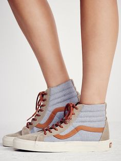 Sk8-Hi Reissue DX Sneaker   Classic Vans sk-8 sneaks that have been reissued with suede accents. These lace-ups have a sturdy rubber sole for an ultra-comfortable wear.