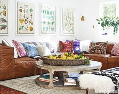 """Leather Sofa LEATHER SOFA """"The mandate was to get the biggest, most comfortable and indestructible sofa that would fit in the space,"""" says designer Frances Merrill of a California living room. The perfect solution was a Fulham leather sectional, paired with a Martens round coffee table, both by Restoration Hardware. Saved from:http://www.housebeautiful.com/room-decorating/living-family-rooms/g715/designer-living-rooms/?slide=7"""