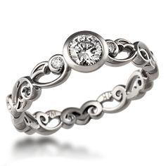 like this a lot :) prefer a set up diamond but i like the side diamonds on this!