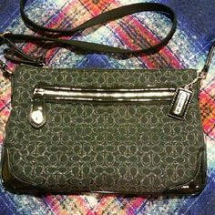 Small Coach Crossbody Black with silver needlepoint  C's.  Black patent leather accents on corners and along zipper with turn lock on front zippered pocket.  Plum satin interior.  Thick fabric strap.    Measures 10 inches across and 7 inches tall.  Carried 2 weekends.  Just need to downsize some purses! Absolutely beautiful little bag! Coach Bags Crossbody Bags