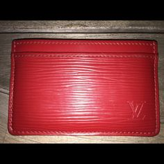 Auth Louis Vuitton Red Epi Slim Card Holder Wallet EPI CARD HOLDER This simple yet chic card holder in Epi leather slips easily into a pocket. It holds credit cards, transport cards or business cards in its three slots.  Beautiful preowned condition. Does show some minor signs of wear: Glazing is parially separated on one compartment but there is no peeling. Corners and glazing show wear. Scratches on front and back, some lint inside. Small chip on one pocket.   Measurements from LV's…