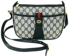 Get the trendiest Cross Body Bag of the season! The Gucci Ophidia Vintage Navy Gg Supreme Canvas Cross Body Bag is a top 10 member favorite on Tradesy. Vintage Coat, Vintage Gucci, Canvas Crossbody Bag, Leather Crossbody Bag, Louis Vuitton Kimono, Brown Canvas, Everyday Bag, Wallet Chain, Green Stripes