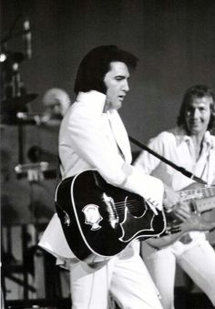 {*Elvis Gorgeous in white*}
