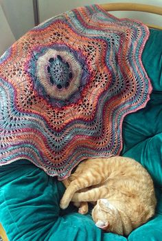Free Knitting Pattern for Hemlock Ring Blanket - This circular lace blanket was inspired by a vintage doily and is easily modified for any size from doily to afghan. Designed as a quick knit in bulky yarn, it's adaptable for other yarn weights. Designed by Jared Flood. Pictured project by Finuin