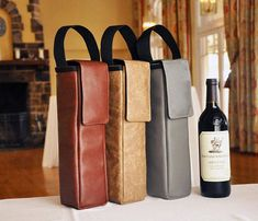 Gorgeous faux leather wine bottle carriers.  The perfect gift for your sophisticated Valentine.  #wine #giftsformen #giftsforhim #giftsfordad #valentinesday #valentinesdaygift #valentinesgift #valentinesdaygiftideas #valentinesgiftforhim #sophisticated #classy #madeinusa