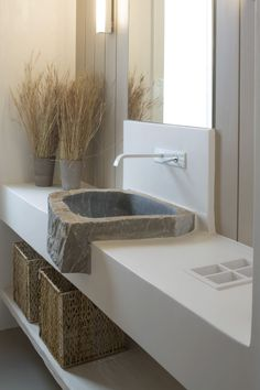This tailor made bathroom's clean forms create a beautiful contrast with the handmade sink, which is made of a sole marble.  Architectural and interior design by A&T Kontodimas Architects. Learn more: http://kontodimas.com/ #interiordesign #design #tailormade #mediterranean