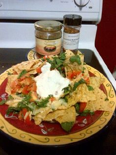 Mediterranean style Your fav nacho chipsLayer over the chips - Couple hand fulls of fresh spinach chopped2 fresh tomatoes diced Shredded feta & mozerella cheeseShake some Mediterranean Blend all over - bake @ 350 until cheese all melted     1tsp Peach mango habanero salsa 1Tbsp Mediterranean Blend mixed into grrek yogurt for dip