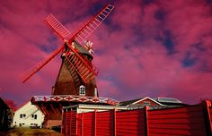 Old windmill dressed in red ! by DanielaDanesiBonatti check out more here https://cleaningexec.com