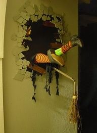 Witch Crash- Its pretty simple. The busted hole is plywood painted black with picture wire attached to hang. The cracked plaster is cut pieces of foam core coated with spray can ceiling texture to mimic stucco. They were painted our house color and hot glued on. I added some snapped 1 x 3s. It could use a couple more.