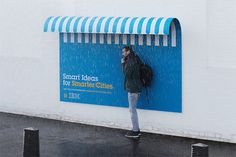 This IBM public billboard is not a useless hoarding but a  public awning, providing a dry space to people as a temporary shelter from the rains. By Ogilvy France.