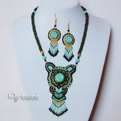 One of a kind bead embroidery necklace and earrings with turquoise bugle beads.