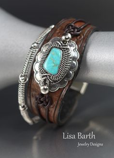 Hand made leather and sterling bracelet with a bezel set turquoise.  I am actually writing a book right now on how to make this, it is due out spring, 2016.  -Lisa Barth