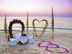 Pink and purple floral beach setting