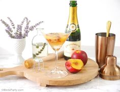 Lavender & Peach Champagne Cocktail Recipe - Delicious, easy cocktail to make for summer parties or just because! - BirdsParty.com @birdsparty