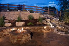 7 DIY Ways To Make Your Patio Awesome A contemporary style patio with a raised garden bed, stone retaining wall and stone fire pit surround. See 7 ways to make your patio even more awesome. Fire Pit Backyard, Backyard Patio, Backyard Landscaping, Landscaping Ideas, Large Backyard, Stone Landscaping, Landscaping Supplies, Landscaping Company, Concrete Patios