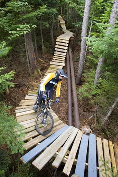 nice ramp through the trees...it's like a zip-line for bikes!! Sunday River Mountain Bike Park, New England.