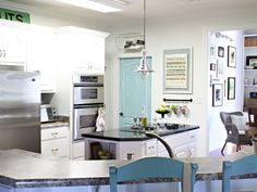 Nate Berkus: House Proud: Perfectly Imperfect...........white kitchen, blue door