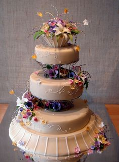 Flowers and Baskets by Art Cake. Wow, look at the flowers in between the tiers – very cool!