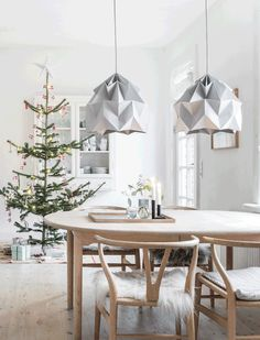 A simple yet cosy festive Nordic home. Beautiful scandinavian christmas tree