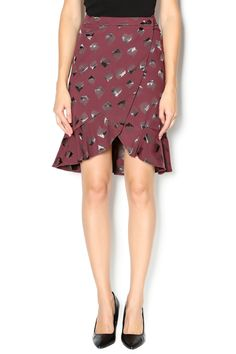 Gorgeous abstract heart print skirt in deep garnet with a wrap style front and buttons. Opens in front with a subtle ruffle hem.