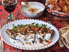 Eggplant with yogurt sauce (Fattet al-Makdoos)--This usually sits on a bed of fried pita bread, but it can use GF fried croutons instead. Lebanese Recipes, Turkish Recipes, Ethnic Recipes, Arabic Recipes, Lebanese Cuisine, Persian Recipes, Middle Eastern Dishes, Middle Eastern Recipes, Eggplant Dishes