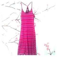 Pink and purple stripe racer back tank dress S Mountain Hardware pink and purple striped racer back tank midi length dress. Has a built in shelf bra. Worn just a couple of times, comes from a smoke free, pet free home. Mountain Hard Wear Dresses