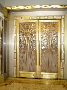 Art Deco Lalique signed doors, originally designed for Alexander and Oviatt's Haberdashery, now the front doors of Cicada Restaurant in downtown Los Angeles, USA.