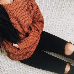 Burnt orange sweater.