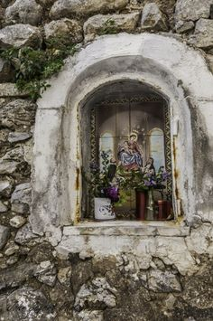 One of the many small shrines embedded into the walls in the village of Praiano