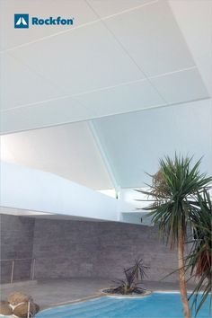 The Arts et Vie vacation residence in Plozévet, France, is designed for people of all ages. The challenge is to create an environment that offer a pleasant experience. The solution came with acoustic ceiling tiles. Not only did they control the reverberation and improved the acoustic comfort but also gave aesthetics in a monolithic looking ceiling design. Best of both worlds? #SoundsBeautiful #Rockon #acoustic #design #inspiration #pool #swimming #designforleisure #france Ceiling Design, Wall Design, Visual Comfort, Natural Stones, Acoustic Ceiling Tiles, Chicago Metallic, Indoor Swimming Pools, Grid System, Ceilings