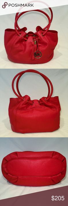 Michael Kors Rings Tote Michael Kors Rings Tote. Beautiful red!! Red tassel with gold logo medallion.  This bag has one main large compartment with magnetic closure, side zip pocket and 4 side slip pockets.  Interior has Michael Kors signature lining.  Large enough for a small laptop or tablet  plus anything else you need to carry!  This bag can be worn on your shoulder.  No marks inside or out. I don't remember using it, but the tags are removed. Michael Kors Bags