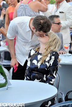 : Andrew Garfield kissed Emma Stone during the charity bash.
