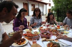 Scenes from Peloponnese, Greece: Family lunch in the backyard under a carob tree.