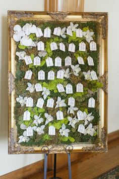 This escort card board is so unique!  Photo: Watson-Studios