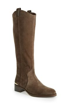 Free shipping and returns on Louise et Cie 'Zada' Knee High Riding Boot (Women) (Nordstrom Exclusive) at Nordstrom.com. Slip into some equestrian-inspired style with this rich leather riding boot from Louise et Cie. The minimalist design allows the details to shine, like the gleaming rand at the heel, pull tabs at the curved topline and a gilded zip pull. An almond toe and low, stacked heel complete the look.