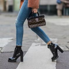 Supple Rigid case designed by Ghesquière for the fall/winter runway collection. Military Boots Outfit, Combat Boot Outfits, Winter Boots Outfits, Winter Outfits, Combat Boots, Platform Boots Outfit, Louis Vuitton Boots, Jeans With Heels, Citizens Of Humanity Jeans