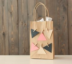 Embossed Paris Map Triangle Gift Bag. Make It Now with the Cricut Explore machine and Cuttlebug in Cricut Design Space.