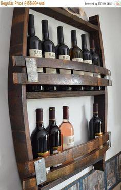 June Sale California Wine Barrel wine rack holds 12 - 14 bottles made from reclaimed wine barrels Whisky Regal, Wine Barrel Crafts, Barolo Wine, Wine Barrel Furniture, Barrel Projects, Rustic Wine Racks, Unique Wine Racks, Wine Glass Holder, Wine Racks