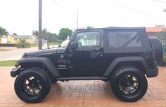 Jeep Wrangler Sport 2013 with 3.25 suspension lift and 20 inch Moto Metal rims on 35 x 13.50 Nitto Terra Grapplers