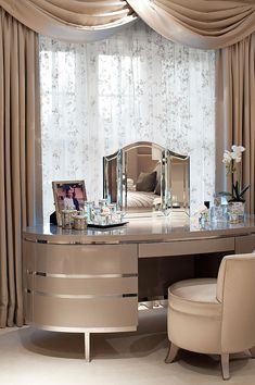 Very elegant table....but with a vanity like that, the entire room would have to match. love the curvature vs. hard edges...