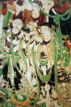 """文殊變伎樂,敦煌第159窟,中唐,文殊普賢是釋迦牟尼佛的左右肋侍菩薩,在佛國世界里文殊司智慧,在諸大菩薩中,以智慧辯才第一,尊號""""大智文殊""""。該畫面是文殊變中,伎樂菩薩奏樂的景象,高立在蓮花座上,吹笙鳴笛,好致。"""