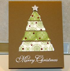 Christmas card made with torn strips of green patterned scrapbook paper, arranged into a tree shape with a silver star affixed on top.