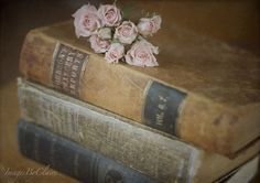 Old books and spray roses