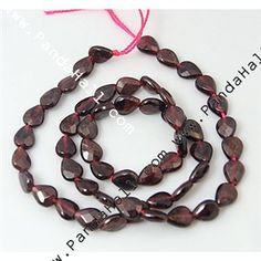 Garnet, vertical drilled, faceted, 8x5x4mm.  5 strands (53 beads/strand) for $35.85.