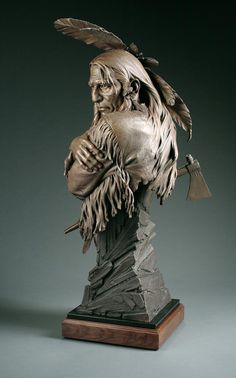 Artist and sculptor Blair Buswells life size How Many More..., winner of the James Earle Frazer award at the Prix de West Show 2011, fine art sculpture of Native American indian folding arms with tomahawk