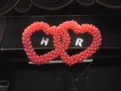 Interlinked Double Heart sculptures with initials of wedding couple inside hearts